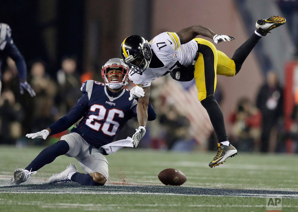 New England Patriots cornerback Logan Ryan (26) breaks up a pass intended for Pittsburgh Steelers wide receiver Eli Rogers (17) during the second half of the AFC championship NFL football game, Sunday, Jan. 22, 2017, in Foxborough, Mass. (AP Photo/Charles Krupa)