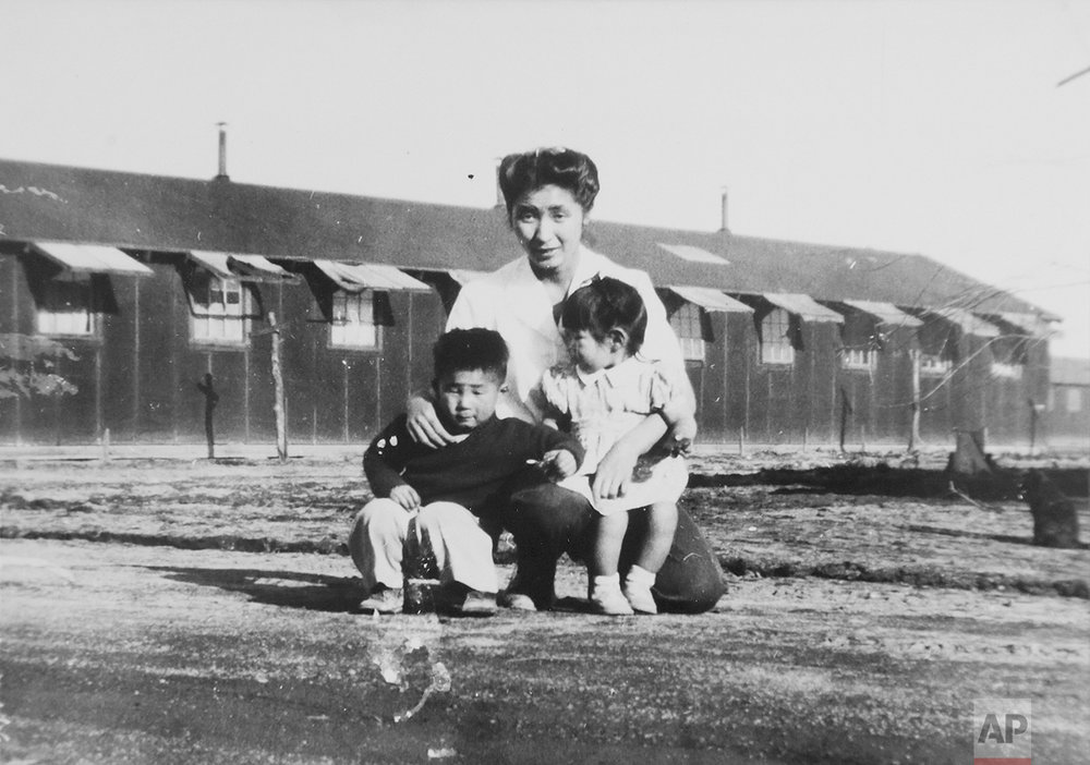 This 1945 photo provided by the family shows Shizuko Ina, with her son, Kiyoshi, left, and daughter, Satsuki, in a prison camp in Tule Lake, Calif. This photo was made by a family friend who was a soldier at the time, since cameras were considered contraband at the camp. Satsuki was born at the camp. (Courtesy of the Ina family via AP)
