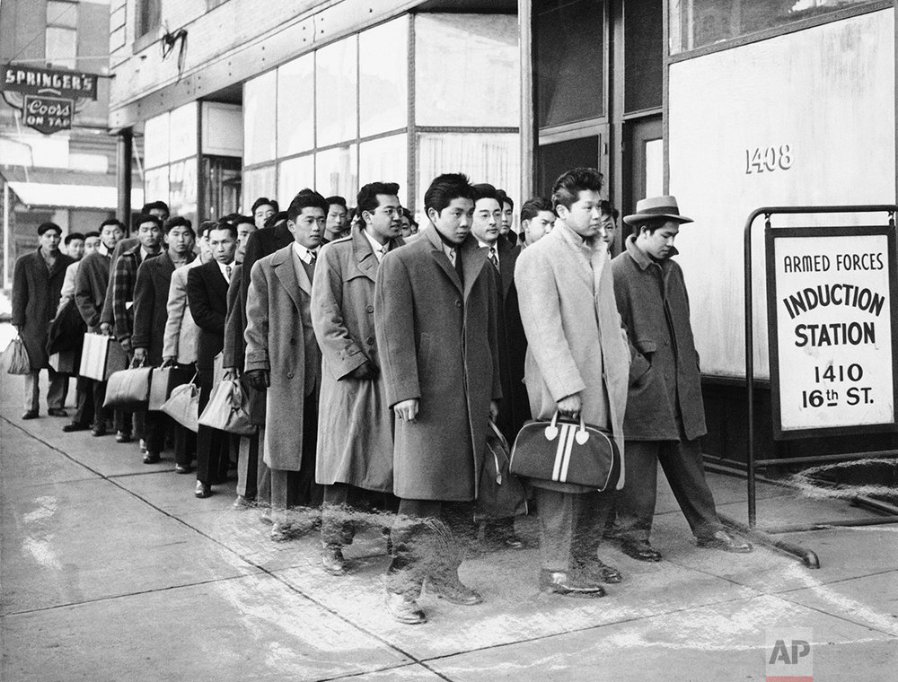 These 48 Japanese Americans from the Granada Relocation Center near Lamar, Colorado, reported for preinduction physical examinations at the Denver Induction Station Tuesday, February 22, 1944. (AP Photo)