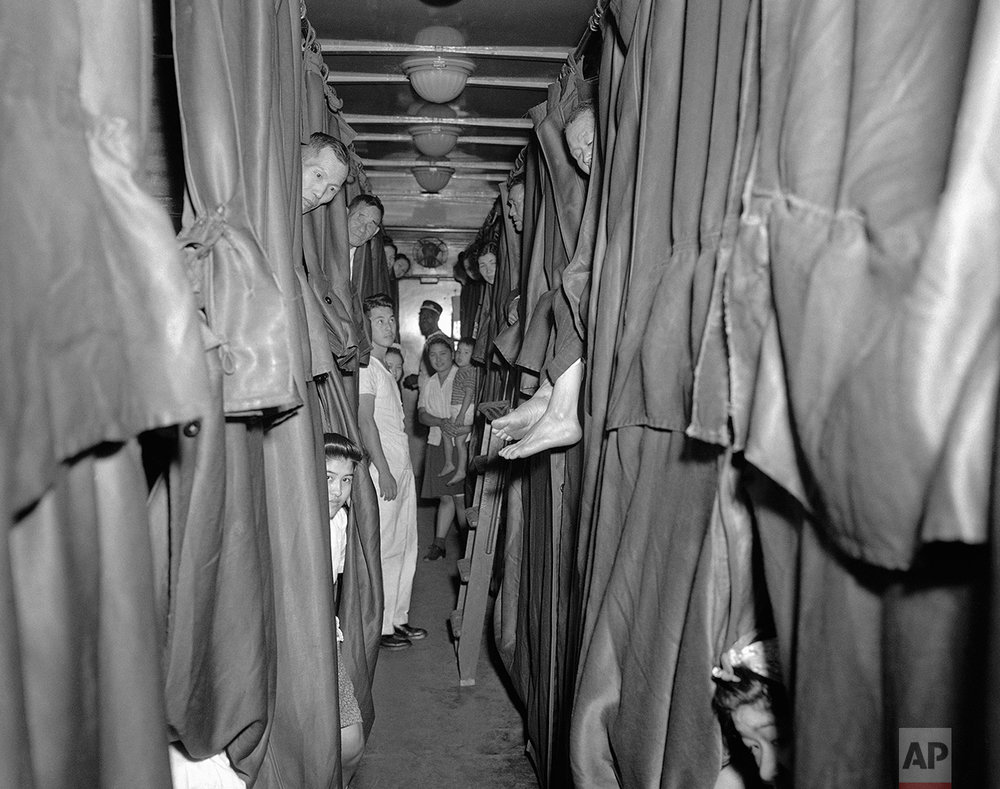 The aged, the sick and women with nursing babies are among  427 persons of Japanese origin returning in a special train from the Rohwer, Ark., Relocation Center to California ride in this tourist Pullman, July 28, 1945. (AP Photo)