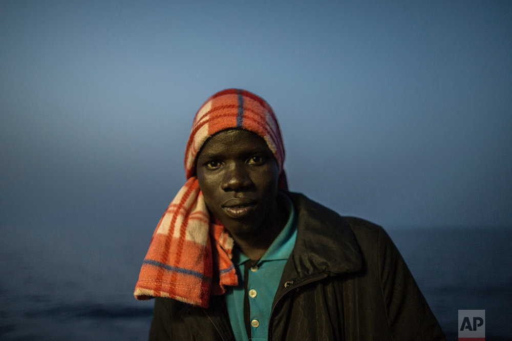 Souleman Traore, 20, from Bamako, Mali, poses for a photograph aboard the Golfo Azurro, the Spanish NGO Proactiva Open Arms rescue ship after being rescued off the Libyan coast, early in the morning on Thursday Feb. 23, 2017. (AP Photo/Santi Palacios)