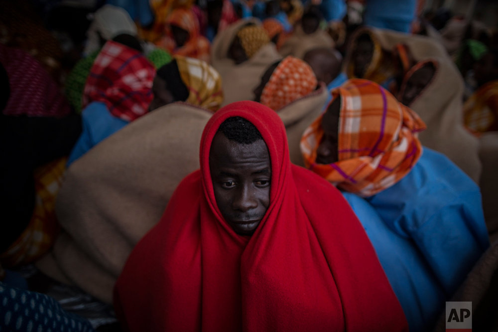 Refugees and migrants rest aboard the Golfo Azurro, the Spanish NGO Proactiva Open Arms rescue ship after being rescued off the Libyan coast, early in the morning on Thursday Feb. 23, 2017. (AP Photo/Santi Palacios)
