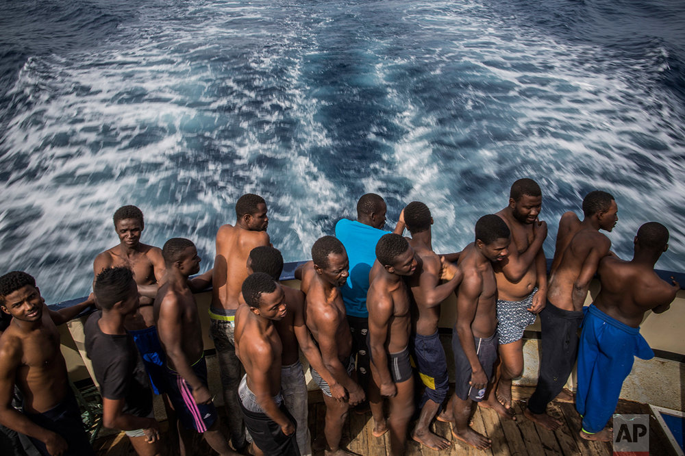 Refugees and migrants rest aboard Golfo Azurro, the Spanish NGO Proactiva Open Arms rescue ship, after being rescued from a boat out of control at 25 miles north of Sabratha, off the Libyan coast, early in the morning on Thursday Feb. 23, 2017. (AP Photo/Santi Palacios)