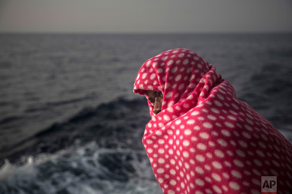 A man rests aboard Golfo Azurro, the Spanish NGO Proactiva Open Arms rescue ship, after being rescued from a boat out of control at 25 miles north of Sabratha, off the Libyan coast, early in the morning on Thursday Feb. 23, 2017. (AP Photo/Santi Palacios)