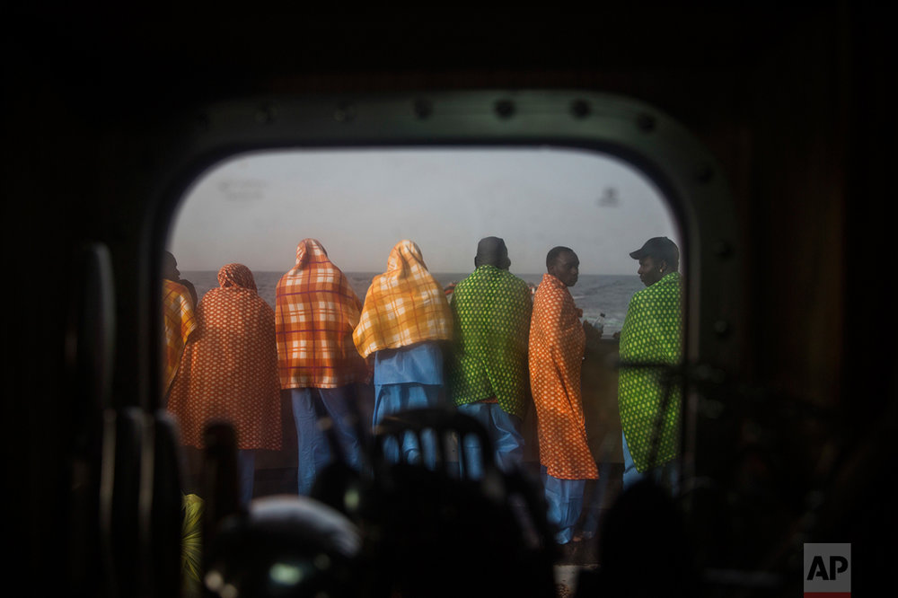 African refugees and migrants, mostly from Sudan and Senegal, look at the sea aboard Golfo Azurro, the Spanish NGO Proactiva Open Arms rescue ship, after being rescued from a boat out of control at 25 miles north of Sabratha, off the Libyan coast, early in the morning on Thursday Feb. 23, 2017. (AP Photo/Santi Palacios)
