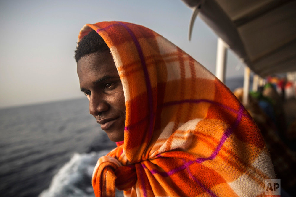 A migrant rests aboard Golfo Azurro, the Spanish NGO Proactiva Open Arms rescue ship, after being rescued from a boat out of control at 25 miles north of Sabratha, off the Libyan coast, early in the morning on Thursday Feb. 23, 2017. (AP Photo/Santi Palacios)