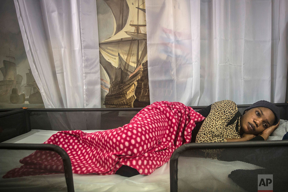 A pregnant woman from Nigeria rests aboard Golfo Azurro, the Spanish NGO Proactiva Open Arms rescue ship, after being rescued 25 miles north of Sabratha, off the Libyan coast, early in the morning on Thursday Feb. 23, 2017. (AP Photo/Santi Palacios)
