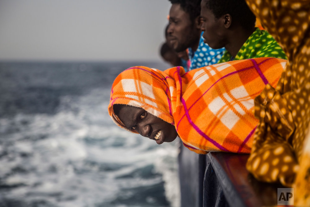 African refugees and migrants, mostly from Sudan and Senegal, look at the sea aboard the Golfo Azurro, a rescue ship of the Spanish Proactiva Open Arms NGO, after being rescued from a boat out of control at 25 miles north of Sabratha, off the Libyan coast, early in the morning on Thursday Feb. 23, 2016. (AP Photo/Santi Palacios)