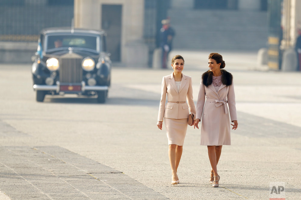 Spain's Queen Letizia, left, walks with Juliana Awada, the wife of the Argentina's President Mauricio Macri, during a welcome ceremony at the Royal Palace in Madrid, Wednesday, Feb. 22, 2017. Macri and his wife Awada are on the first of a four day official visit to Spain. (AP Photo/Francisco Seco)