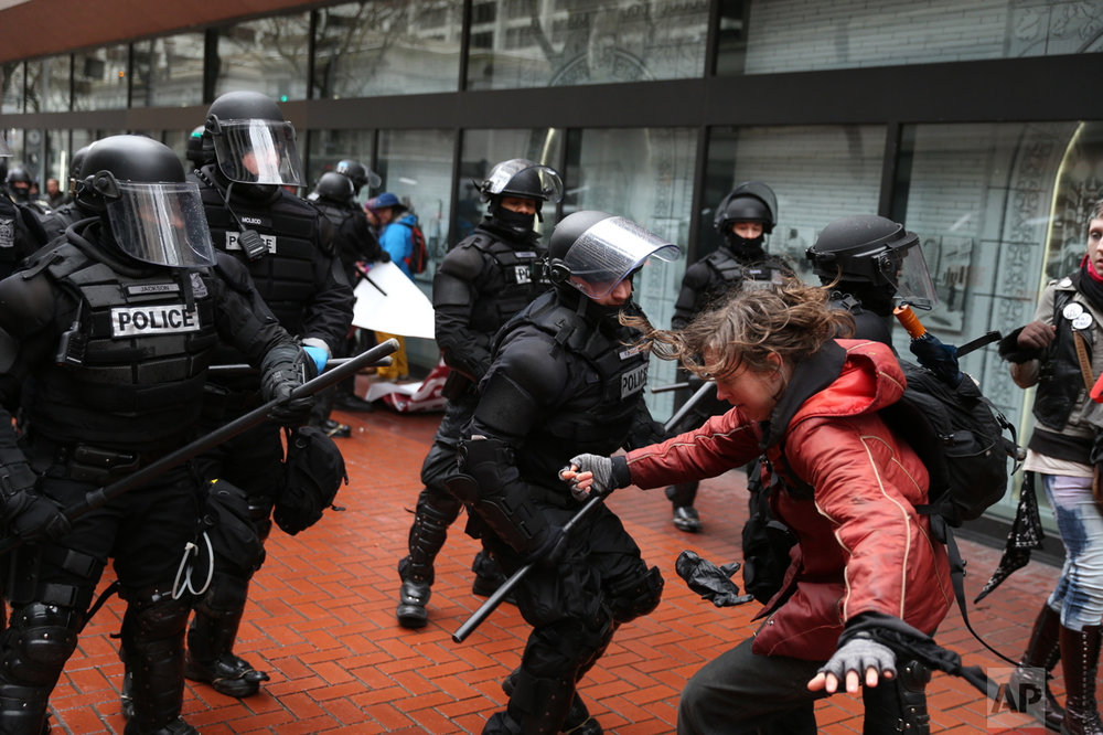 "Protesters clash with police in Portland, Ore., on Monday, Feb. 20, 2017. Thousands of demonstrators turned out Monday across the U.S. to challenge President Donald Trump in a Presidents Day protest dubbed ""Not My President's Day."" (Dave Killen/The Oregonian via AP)"