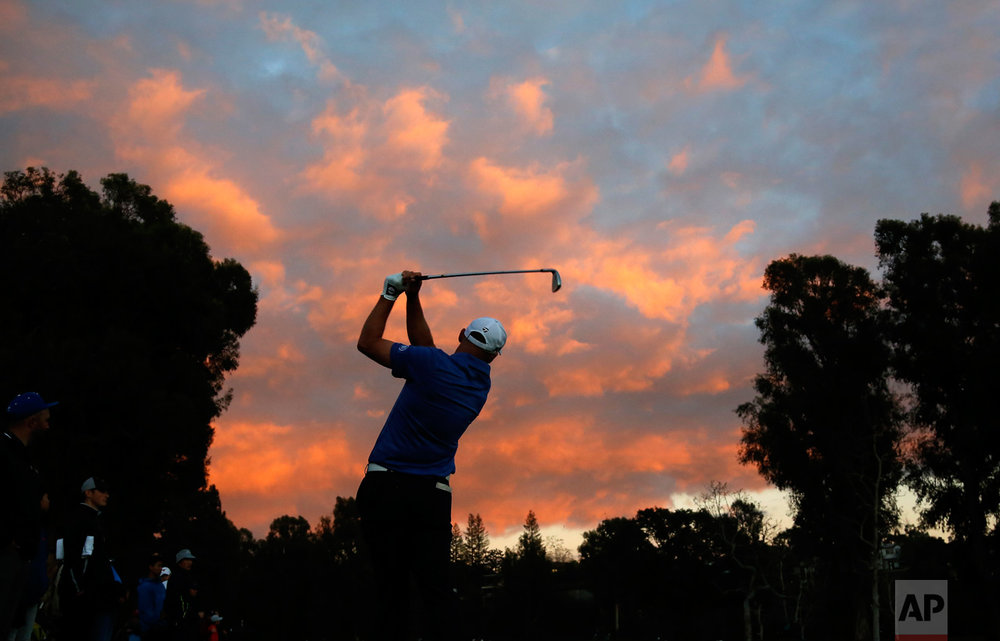 Cameron Percy hits his approach shot on the first hole during the third round of the Genesis Open golf tournament at Riviera Country Club, Saturday, Feb. 18, 2017, in the Pacific Palisades area of Los Angeles. (AP Photo/Ryan Kang)
