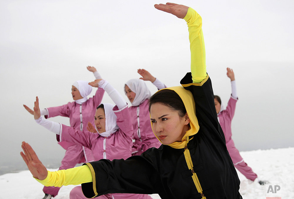 Shaolin martial arts students follow their trainer, Sima Azimi, 20, in black, during a practice session on a hilltop in Kabul, Afghanistan, Tuesday, Jan. 25, 2017. The ten ethnic Hazara women and girls practice the martial arts of Shaolin on a hilltop in the west of Kabul. They are preparing for the day that Afghanistan can send its women's team to the Shaolin world championship in China. (AP Photos/Massoud Hossaini)