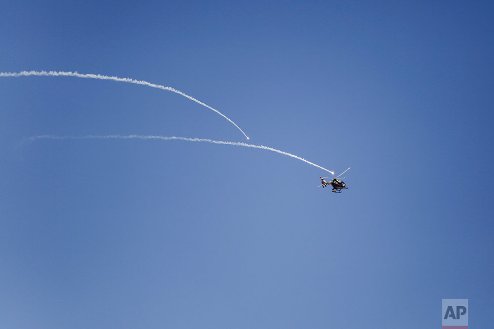 An Iraqi army helicopter fires at Islamic State militant positions outside the town of Abu Saif, Monday, Feb. 20, 2017. (AP Photo/Bram Janssen)