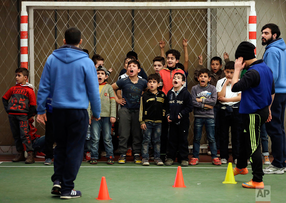 Syrian refugee boys scream as they attend a soccer training session at a private sports club, southern Beirut, Lebanon on Sunday, Feb. 19, 2017. Every Sunday the gymnasium in Beirut echoes with the shouting and laughter of dozens of children, mostly Syrian refugees enjoying a rare escape from a grim and cloistered life in exile. (AP Photo/Hussein Malla)
