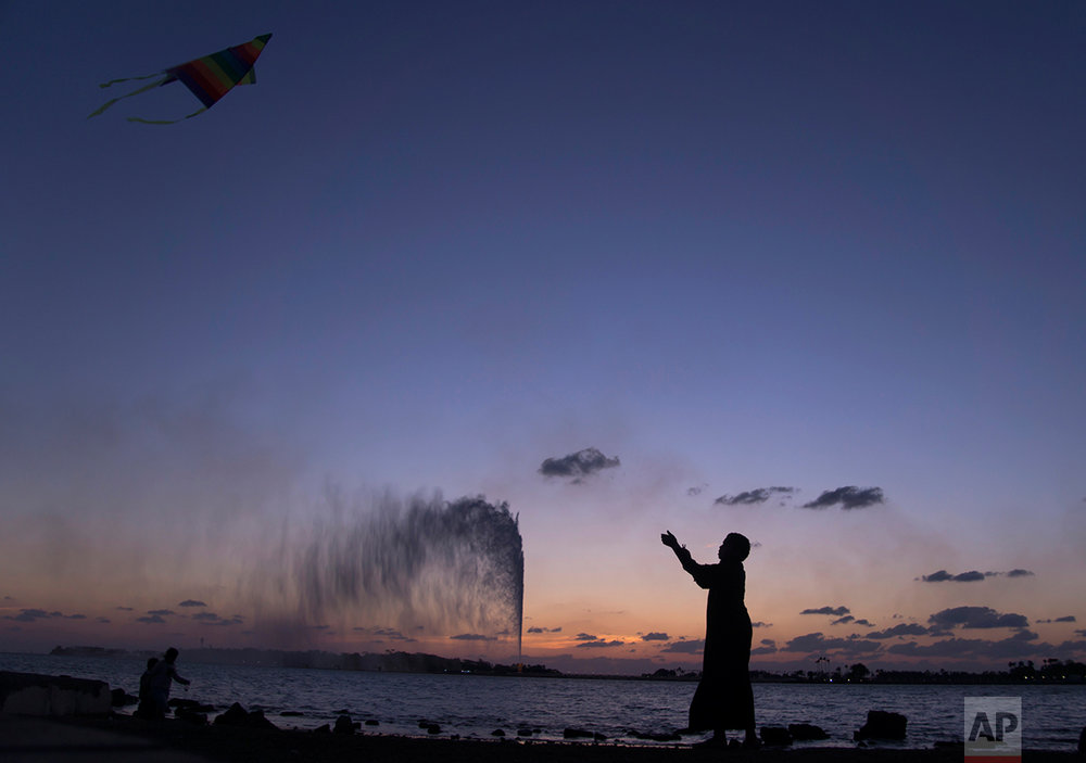 A boy flies a kite on the Red Sea beach near the landmark Jiddah fountain, in Jiddah, Saudi Arabia, Monday, Feb. 20, 2017. (AP Photo/Amr Nabil)