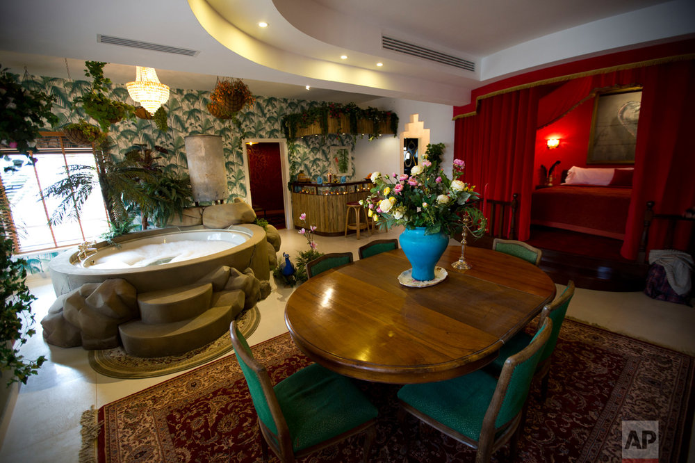 "The presidential suite of the The Walled Off Hotel"" in the West Bank city of Bethlehem, Friday, March 3, 2017. The owner of a guest house packed with the elusive artist Banksy's work has opened the doors of his West Bank establishments to media, showcasing its unique ""worst view in the world."" The nine-room hotel named ""The Walled Off Hotel"" will officially open on March 11. (AP Photo/Dusan Vranic)"