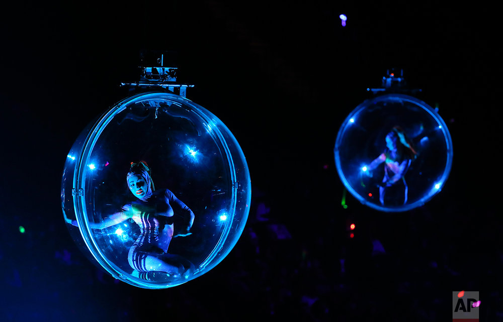 Acrobats perform in transparent balls hung from the rafters during the opening night show of the Ringling Bros. and Barnum & Bailey Circus, Thursday, Feb. 23, 2017, in New York. (AP Photo/Julie Jacobson)