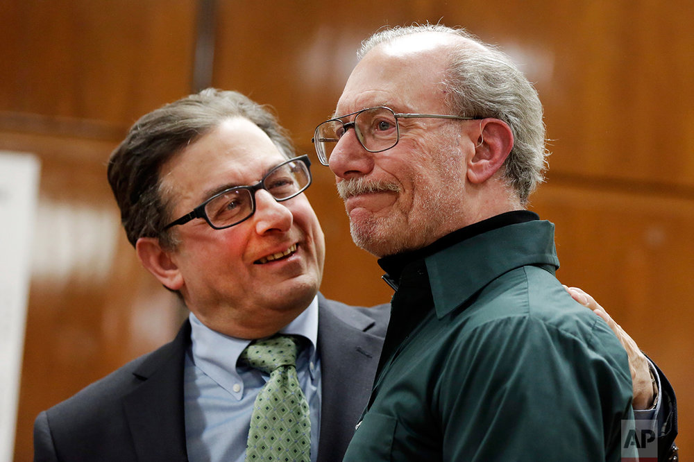 Stan Patz, right, father of 6-year-old Etan Patz who disappeared on the way to the school bus stop 38 years ago, reacts after a news conference with Assistant District Attorney Joel Seidemann, following the second trial of Pedro Hernandez, whos convicted of killing the boy, Tuesday, Feb. 14, 2017, in New York's Manhattan Supreme Court. (AP Photo/Richard Drew)