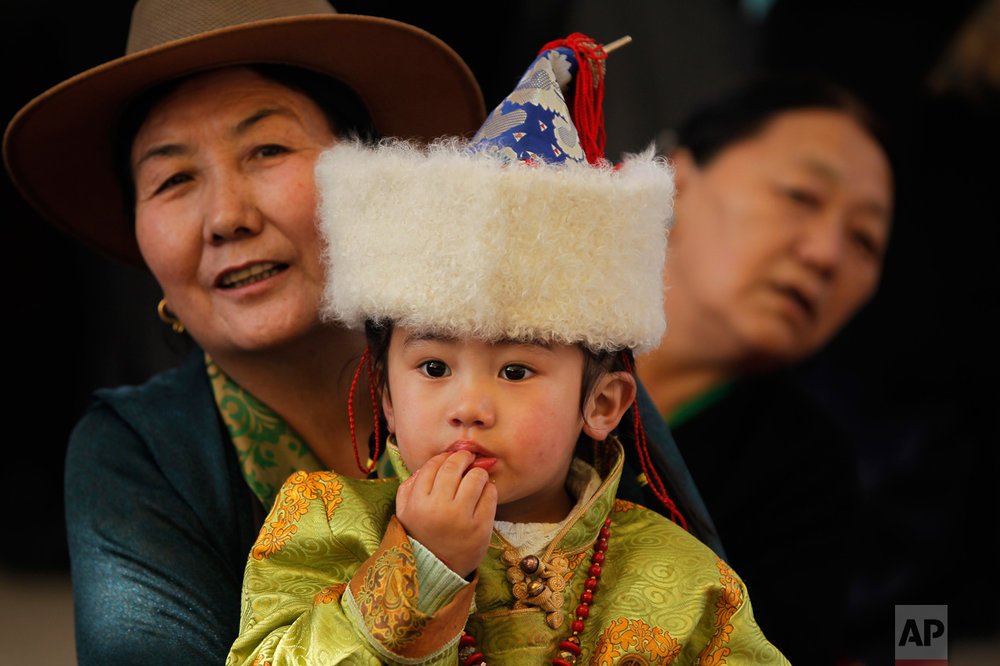 Tibetans gather during a special prayer ceremony on the third day of the Tibetan New Year celebrations in Kathmandu, Nepal, Wednesday, March 1, 2017. (AP Photo/Niranjan Shrestha)