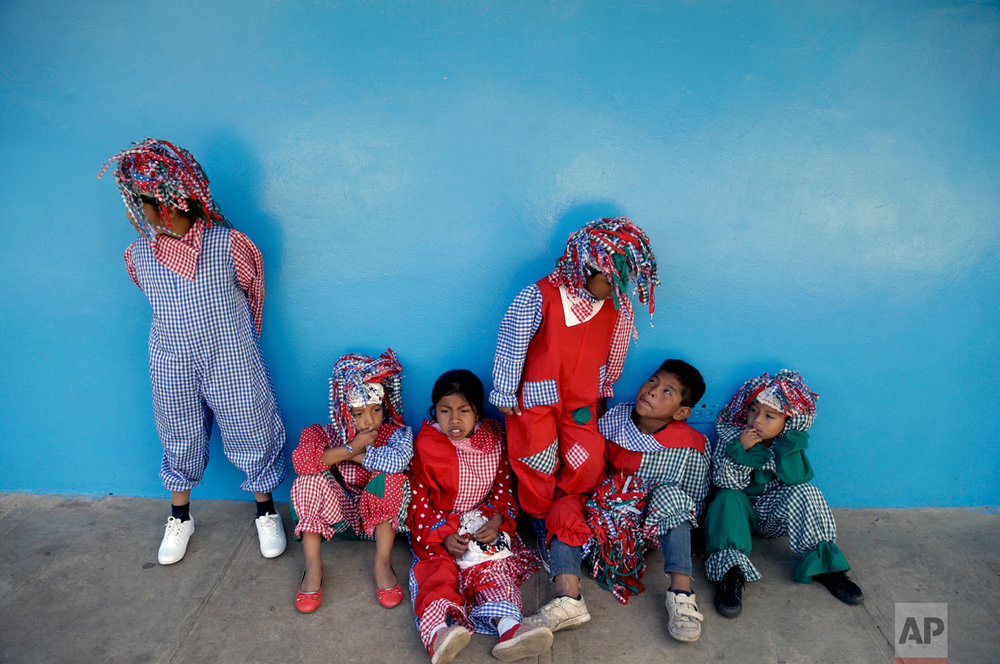 "Children dressed as clowns wait to dance for Nobel Peace Prize Laureate Kailash Satyarthi, from India, as he visits the school ""Casa Esperanza,"" or Hope Home, in Boquete, Panama, Tuesday, Feb. 7, 2017. Satyarthi is in Panama at the invitation of the first lady Lorena Castillo de Varela who is working in eradicate child labor. Casa Esperanza, which offers fee education to the children of poor, mostly hired farm hands, say they have rescued more than 30,000 children from child labor since 1992. (AP Photo/Arnulfo Franco)"