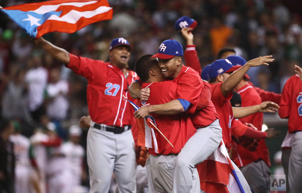 Puerto Rico's Criollos de Caguas players celebrate after the team won the Caribbean Series baseball championship title game, 1-0 over Mexico's Aguilas de Mexicali in Culiacan, Mexico, Tuesday, Feb. 7, 2017. (AP Photo/Luis Gutierrez)