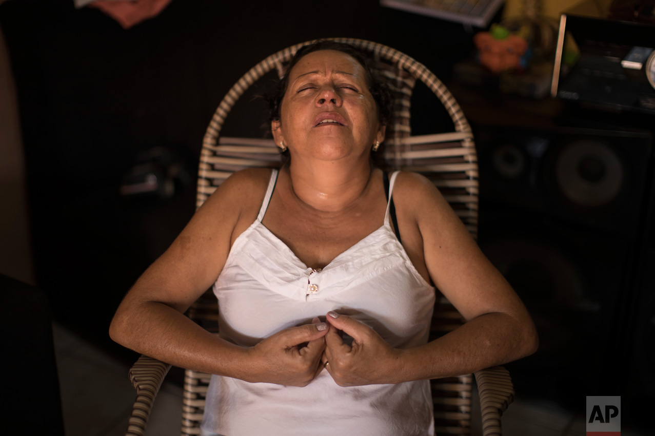 In this Jan. 23, 2017 photo, Maria Jose de Souza reacts as she talks about her husband who died in a massacre inside Alcacuz prison in Natal, Brazil. A surviving inmate posted cellphone video of the carnage on WhatsApp, and Souza recognized a tattoo on the body of her beheaded husband. He had been in prison for three years for robbery and manslaughter, and was to be released in June. (AP Photo/Felipe Dana)