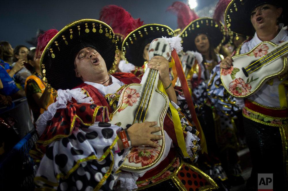 A performer from the Academicos do Grande Rio samba school parades during Carnival celebrations at the Sambadrome in Rio de Janeiro, Brazil, Monday, Feb. 27, 2017. (AP Photo/Mauro Pimentel)