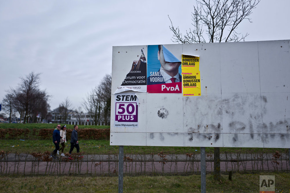 In this Friday, March 3, 2017 photo, an election billboard with posters of various political parties is displayed on a roadside in Lisse, Netherlands. March 15 marks the general election in the Netherlands. (AP Photo/Muhammed Muheisen)