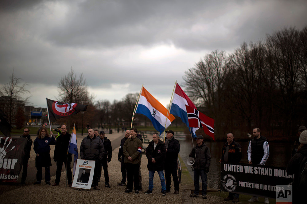 In this Saturday, March 4, 2017 photo, members and supporters of the extreme right wing Nederlandse Volks-Unie (Netherlands People's Union) demonstrate in The Hague ahead of Parliamentary elections scheduled for March 15. The NVU is not fielding any candidates in the election but said it was using Saturday's demonstration to give its supporters voting advice. (AP Photo/Emilio Morenatti)