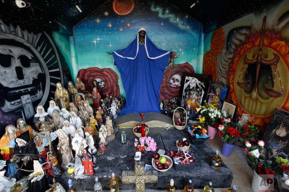 "In this March 1, 2017 photo, images and statues of the Death Saint or ""Santa Muerte"" are displayed on a street altar on the outskirts of Mexico City in the state of Mexico. As devotion expands, shrines to the Death Saint have been appearing in more public places. (AP Photo/Marco Ugarte)"