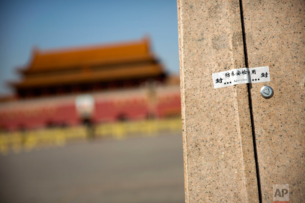 In this Friday, March 10, 2017 photo, an anti-tampering security sticker seals a panel at the base of a light pole on Tiananmen Square near the Great Hall of the People before a plenary session of the Chinese People's Political Consultative Congress (CPPCC) in Beijing. (AP Photo/Mark Schiefelbein)