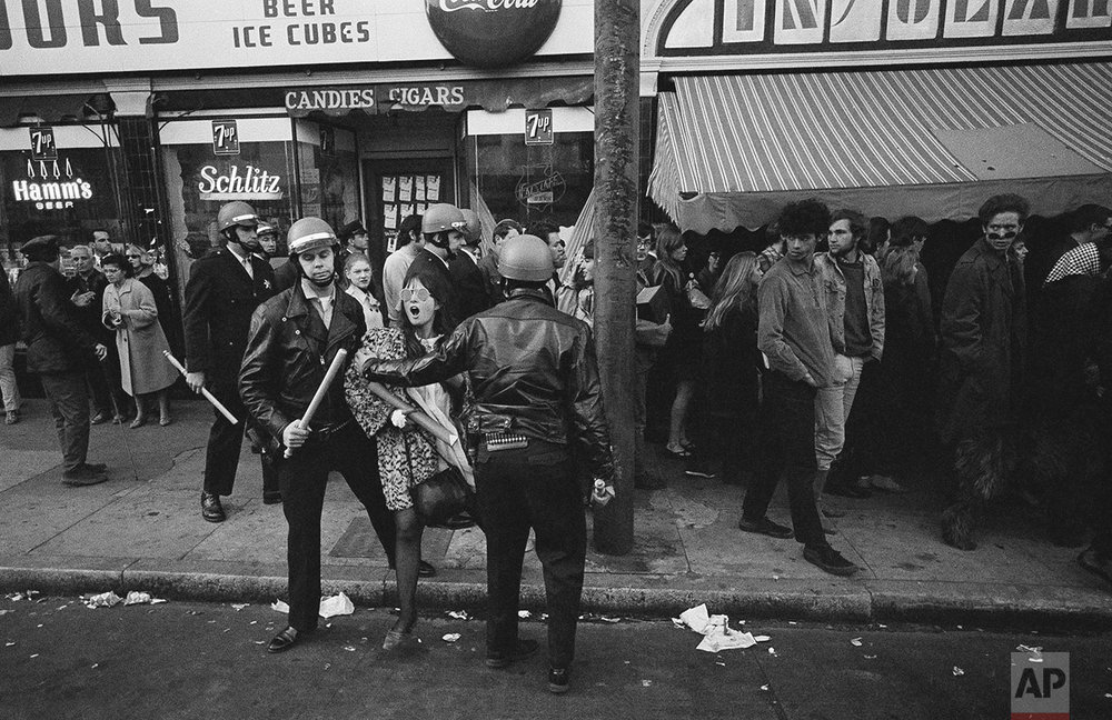 One young woman was unhappy about being taken into custody by police in the Haight-Ashbury district, April 3, 1967, San Francisco, Calif. More than 2,000 persons, most of them hipsters from the area, parade around until police started arresting some for unlawful assembly and failure to disperse. (AP Photo/Robert W. Klein)