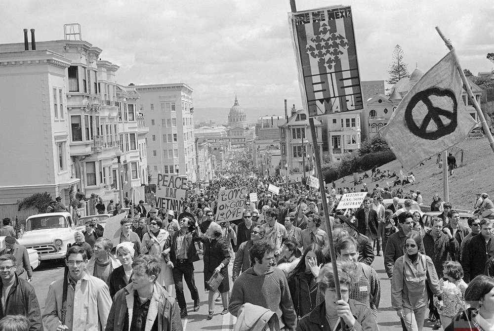 Peace demonstrators fill Fulton Street in San Francisco April  15, 1967 during their five-mile march through the city. The march winds up at Kezar Stadium where a peace rally will be held. Groups came from Los Angeles and the Northwest to join in the march and rally. San Francisco City Hall is in the background. (AP Photo/Robert W. Klein)