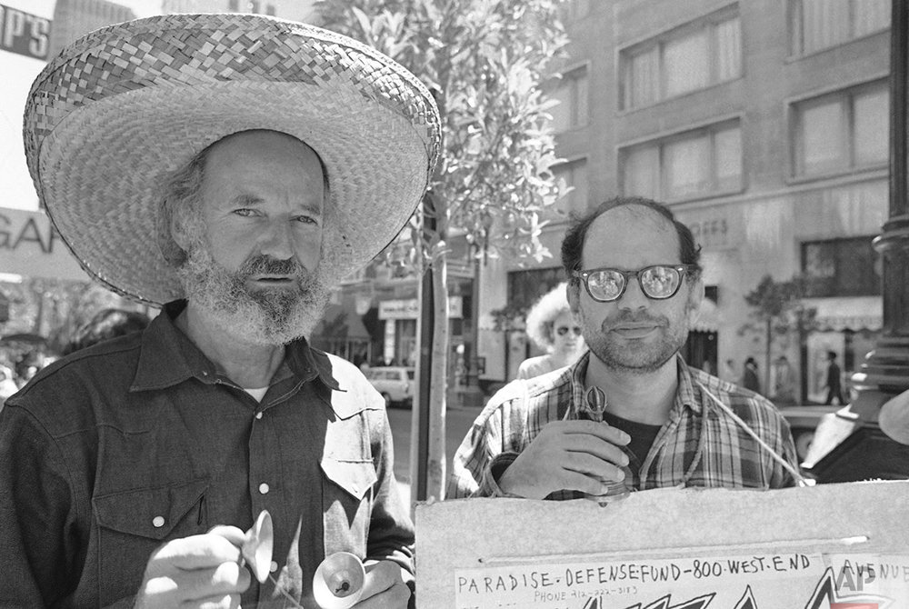 In this Aug. 11, 1971 photo, poet Allen Ginsburg, right, and Lawrence Ferlinghetti, left, join a picket line outside Varig Airlines in protest over theater people who had been arrested in Brazil. (AP Photo/Sal Veder)
