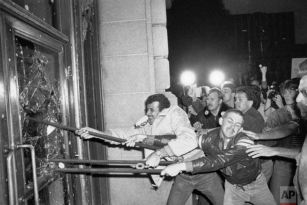 In this May 22, 1979 photo, demonstrators smash glass out of the front doors of the San Francisco City Hall. Thousands marched from the city's gay community to city hall, protesting the voluntary manslaughter conviction of Dan White in the fatal shootings of Mayor George Moscone and city supervisor and gay rights activist Harvey Milk. (AP Photo/Paul Sakuma)