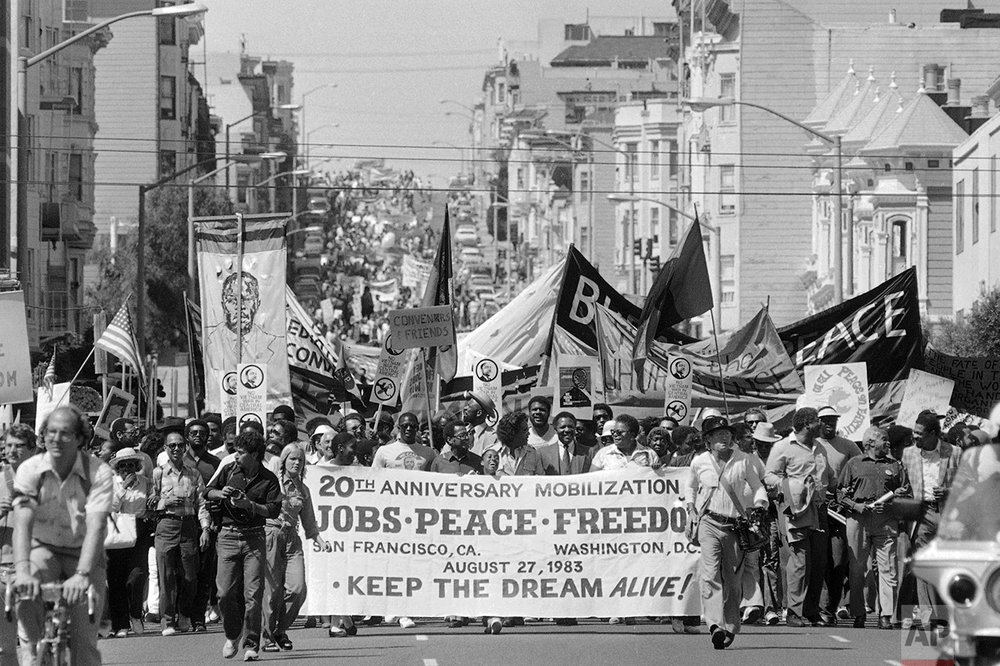 Thousands of people march in downtown San Francisco from Golden Gate Park to City Hall on August 27, 1983 to commemorate the 20th anniversary of the Rev. Martin Luther King's March on Washington. (AP Photo/Paul Sakuma)