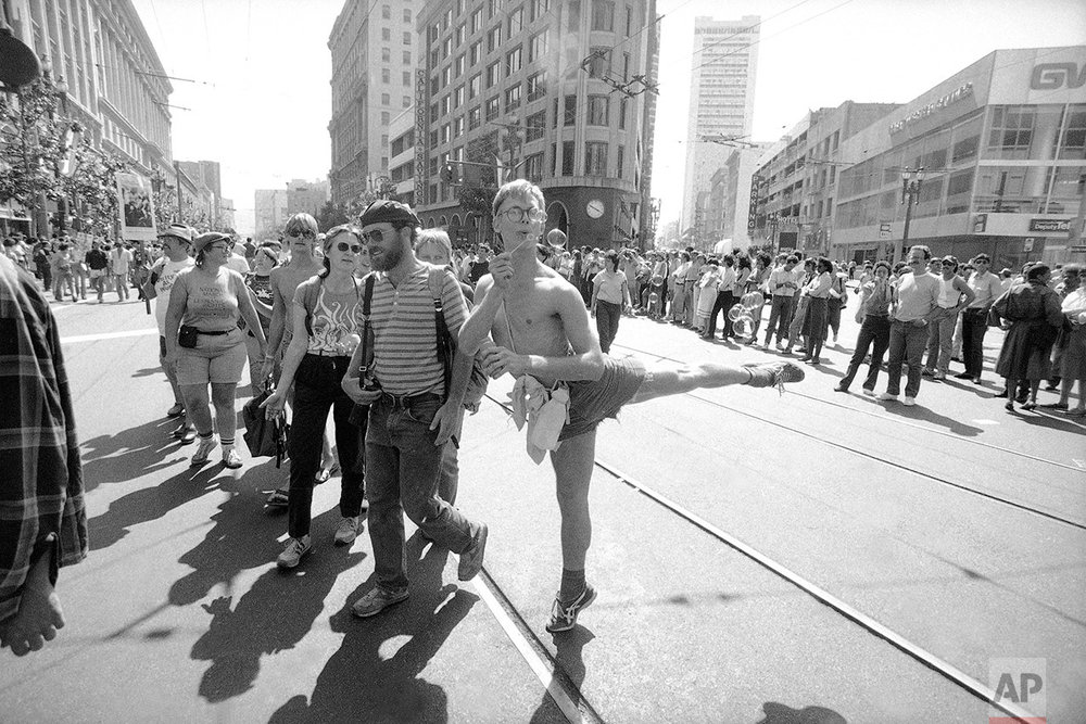 A demonstrator stands on tiptoe and blows bubbles as he participates in a gay rights demonstration in San Francisco, July 15, 1984, on the eve of the start of the 1984 Democratic National Convention. The demonstrators marched two miles carrying banners opposing discrimination and demanding federal funds to combat AIDS. (AP Photo/Joe Skipper)