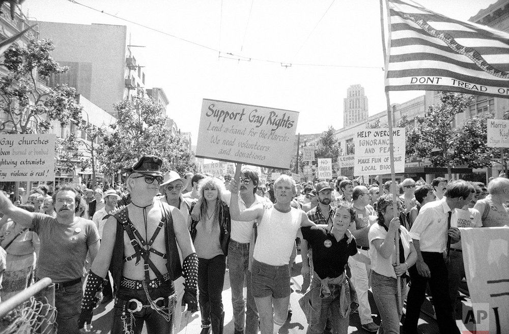 Demonstrators participate in gay rights protest in San Francisco, July 15, 1984, on the eve of the start of the 1984 Democratic National Convention. The demonstrators marched two miles carrying banners opposing discrimination and demanding federal funds to combat AIDS. (AP Photo/Joe Skipper)
