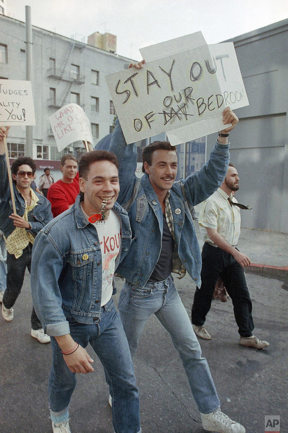 "Members of the San Francisco Gay community march down Market Street protesting Supreme Court Justice Sandra Day O'Conner's visit to San Francisco, Thursday, July 17, 1986, San Francisco, Calif. Justice O'Connor is scheduled to speak to the Bay Area Council on ""The Workings of the Court."" The protest is in response to the Supreme Court's recent ruling on sodomy. (AP Photo/Paul Sakuma)"