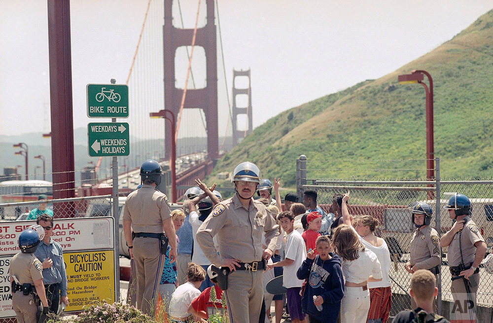California Highway Patrol officers prepare to allow 250 students from various Marin County high schools to march asross the Golden Gate Bridge from Sausalito to San Francisco on Friday, May 1, 1992. The peaceful march was to protest the verdict in the Rodney King trial. (AP Photo/Court Mast)