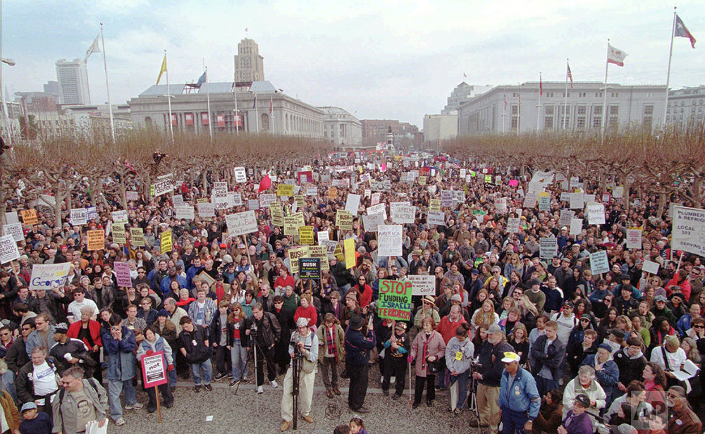 Over 5,000 protesters gather at Civic Center Plaza in San Francisco to denounce the new Bush presidency, Saturday, Jan. 20, 2001. (AP Photo/George Nikitin)