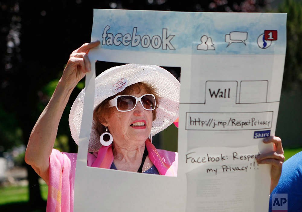 In this June 4, 2010 photo, Gail Sredanovic, of Raging Grannies, protests Facebook's privacy issues outside Facebook headquarters,Palo Alto, Calif. (AP Photo/Paul Sakuma,