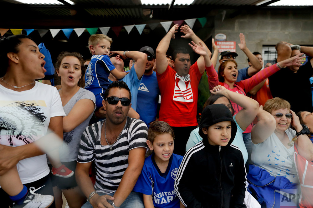 In this Nov. 19, 2016 photo, parents scream as their children play a league soccer game on the outskirts of in Buenos Aires, Argentina. For the thousands of talented youngsters, only a small percentage will become elite players. Some will struggle along the way to overcome injuries. Others will fall to the psychological pressure at home or on the field. (AP Photo/Natacha Pisarenko)
