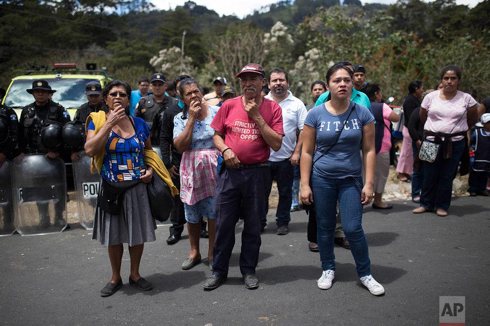 Relatives wait outside the Virgen de la Asunción children's shelter, in San Jose Pinula, Guatemala, on Wednesday, March 8, 2017. (AP Photo/Luis Soto)