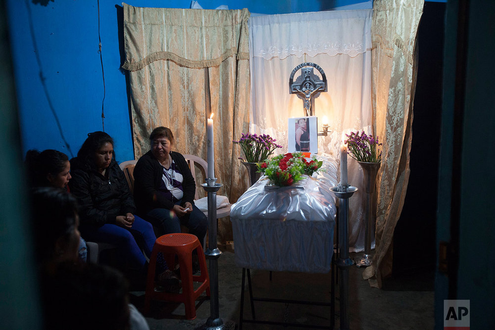 "Neighbors attend the wake of 14-year-old Madelyn Patricia Hernandez Hernandez, a girl who died in a fire at the Virgin of the Assumption Safe Home, at ""Cuatro de Febrero"" neighborhood in Guatemala City, Thursday, March 9, 2017. Guatemala's president called for a restructuring of his country's youth shelter system following a fire that killed multiple girls at an overcrowded government facility for children, while grieving families began receiving the bodies of their loved ones. (AP Photo/Moises Castillo)"