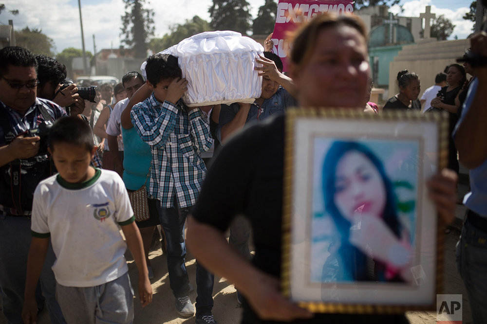 Relatives carry the coffin containing the remains of 17-year-old Siona Hernandez Garcia, a girl who died in a fire at the Virgin of the Assumption Safe Home, at the Guatemala City's cemetery, Friday, March 10, 2017. Families began burying some of the 36 girls killed in a fire at an overcrowded government-run youth shelter in Guatemala as authorities worked to determine exactly what happened. (AP Photo/Luis Soto)