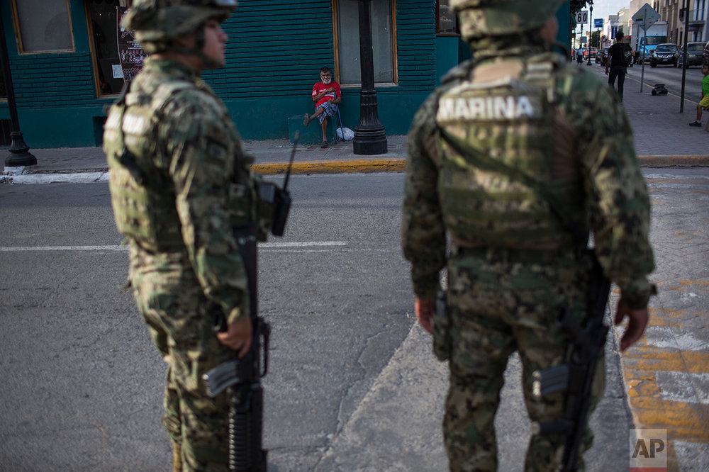 Mexican Marines  patrol downtown in Matamoros, Tamaulipas, Mexico, Wednesday, March, 22, 2017. (AP Photo/Rodrigo Abd)