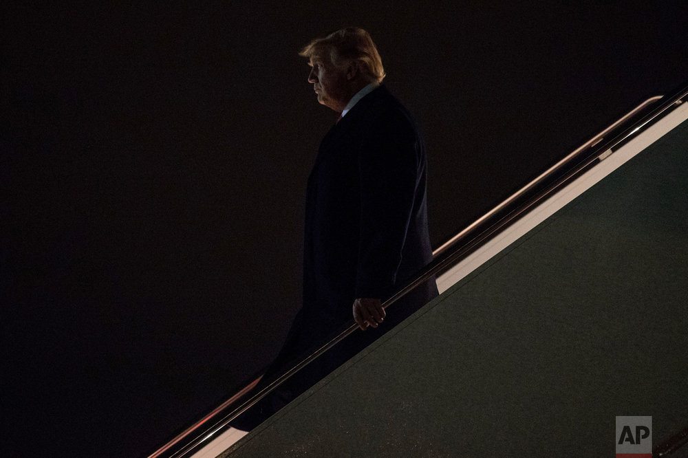 President Donald Trump arrives at Andrews Air Force Base, Md., Monday, March 20, 2017, to board Marine One for a short trip to the White House. Trump spoke at a rally in Louisville, Ky., on Monday. (AP Photo/Andrew Harnik)