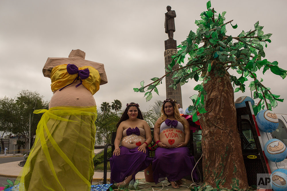 Pregnant women ride on a float during a march against violence organized by local churches in Nuevo Laredo, Tamaulipas state Mexico, Saturday March, 25, 2017. (AP Photo/Rodrigo Abd)