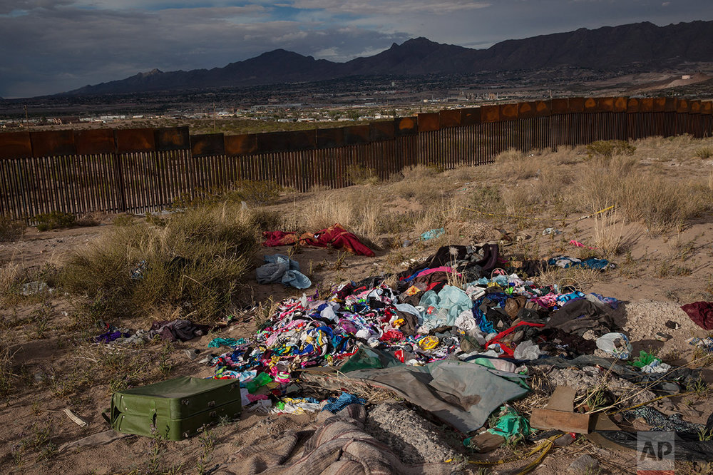 Clothes lay abandoned near a newly erected fence at the U.S.-Mexico border in the Anapra neighborhood of Ciudad Juarez, Mexico, Wednesday, March 29, 2017, across from Sunland Park, New Mexico. Residents of Anapra, a neighborhood anchored to the dunes, have fought to get running water, electricity and some paved streets in recent years. (AP Photo/Rodrigo Abd)